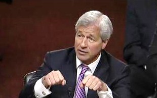 Jamie Dimon, between jobs and mansions in the late 90s, took up boxing.  Here, he shadow boxes with Senate Banking on June 13, 2012.
