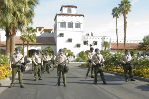 Riverside County Sheriff officers guard the entrance to a Rancho Mirage, California luxury resort where the Koch brothers held their January 2011 political strategy confab.