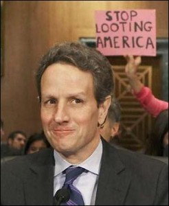 The Non Profit Organization, Code Pink, Appeared on Multiple Occasions Holding Protest Signs Behind Geithner as he Appeared Before Congress to Explain the Massive Bailouts of the Banks