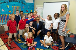 Expect to See Upbeat Photos of the President this Week as He Hits the Road. The President is Shown Here in September 2014 with Elementary Students at a School at MacDill Air Force Base in Tampa, Florida. (Official White House Photo by Pete Souza.)