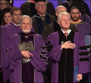 NYU President John Sexton (left); Bill Clinton (right) at the NYU Abu Dhabi Commencement Ceremony on May 25, 2014