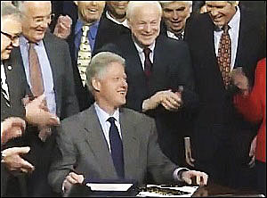 President Bill Clinton Laughs It Up as He Signs the Repeal of the Glass-Steagall Act, November 12, 1999