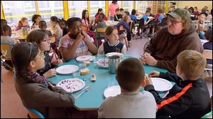 """In a Scene from """"Where to Invade Next,"""" Michael Moore Experiences the Healthy Meal Made By a Chef for Public School Students in France"""