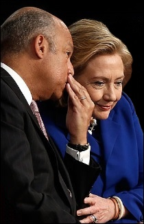 Homeland Security Chief Jeh Johnson Whispers to Hillary Clinton During an Awards Ceremony in 2014