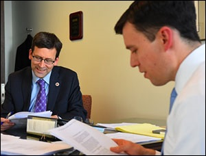 Washington State Attorney General Bob Ferguson (left) and Solicitor General Noah Purcell Read the Ninth Circuit Decision on February 9, 2017