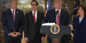 Trump Press Conference at Trump Tower, Tuesday, August 15, 2017. Trump Is Flanked by (left to right) Gary Cohn, Former President of Goldman Sachs, Now Chair of Trump's National Economic Council, Steven Mnuchin, Treasury Secretary, and Elaine Chao, Secretary of Transportation.