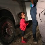This Viral Photo by Pulitzer Prize Winning Photograher John Moore of Getty Images Captures the Trauma of a Two-Year Old Girl from Honduras at the U.S. Southern Border