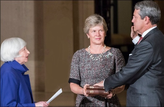Randal Quarles Is Sworn In as Vice Chair of Supervision at the Federal Reserve by Fed Chair Janet Yellen as Wife, Hope Eccles, Holds the Bible